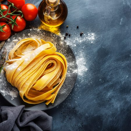 Italian food background with pasta and ingredients for cooking. View from above. Cooking concept