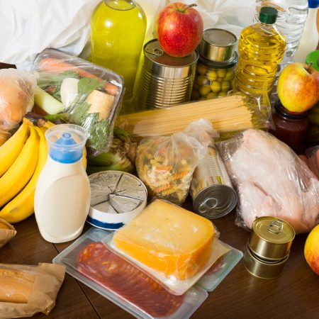View at table with articles of food for  family  in home